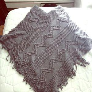 Poncho with zizgzag design